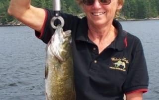 Betty holds a bass.