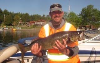 Dan holding 30 inch walleye.