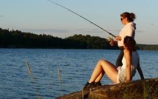 Women fishing off the shore.